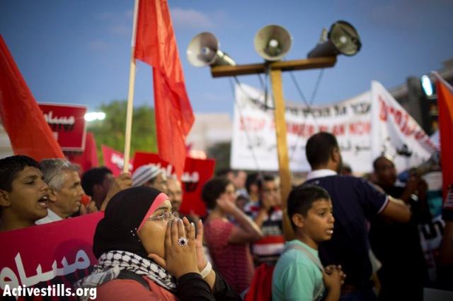Demonstrator at the Anti-Prawer rally in Tel Aviv, September 2013 (Photo: Activestills)