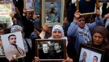 Palestinian women hold framed photos of imprisoned relatives during a rally commemorating the Palestinian prisoners, Ramallah, West Bank, April 17, 2013. April 17th marks Palestinian Prisoners Day (Photo: Activestills)