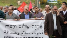Jews and Arabs march during a solidarity event through the Arab city of Umm El Fahem on April 2009. Second from right: MK Afo Agbarieh (Hadash), a leading Communist Party member and Um el-Fahm resident. The event was held in response to the fascist right wing march that was held in Umm el Fahm, causing demonstrations between the residence of the city, which tired to block the march, and the Israeli police (Photo: Activestills)