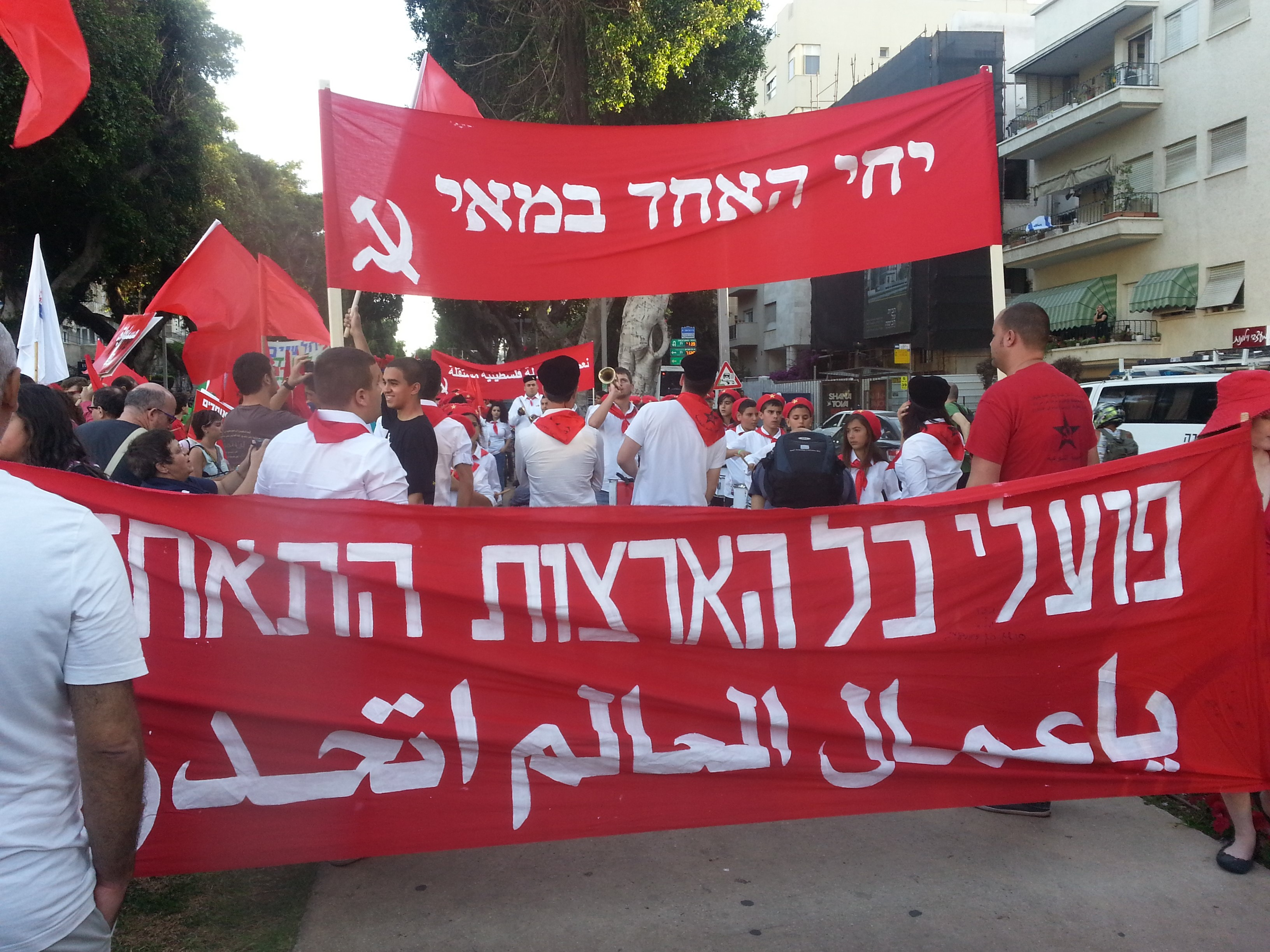 Young Communist League activists during the May Day rally in Tel-Aviv, May 1, 2014 (Photo: Eli Gozansky)
