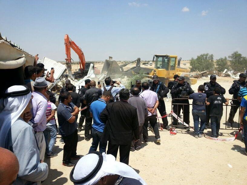 Police forces and Israel Land Authority workers demolishing structures in the unrecognized Bedouin village of Al-Arakib, on Thursday, May 13, 2014 (Photo: Negev Coexistence Forum)