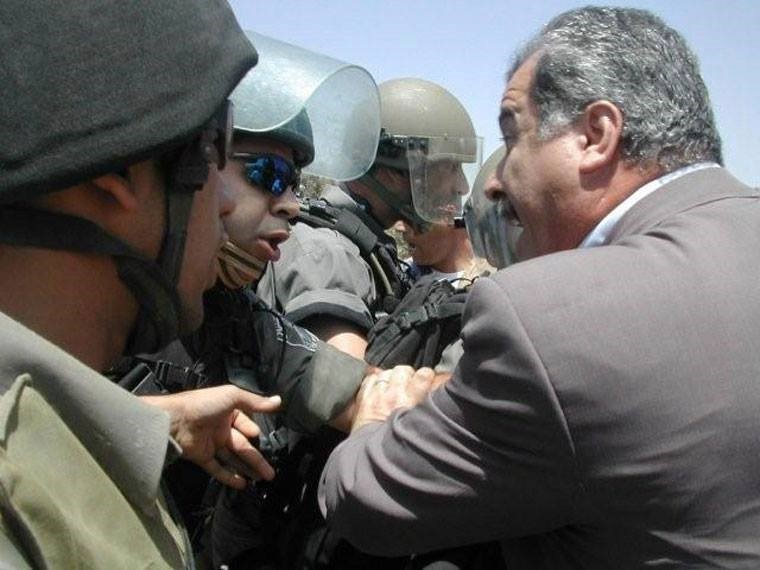 MK Barakeh during a demonstration in the Palestinian village of Bil'in in the occupied West Bank (Photo: Al Ittihad)
