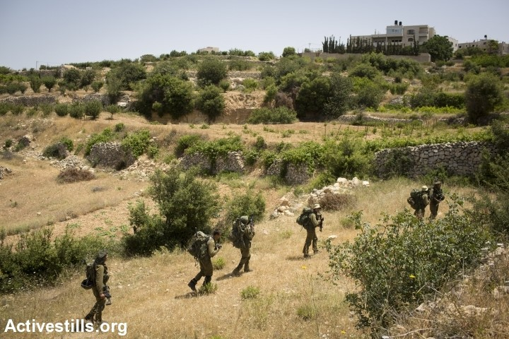 Israeli soldiers enter the city of Halhul, near Hebron, in a search for the three kidnapped teenagers. (Photo: Activestills)