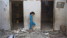 Palestinian young girl in a bombed house in Shatti refugee camp in Gaza Strip (Photo: Activestills)