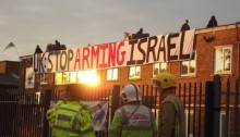 Police look on as protesters occupy the roof of an Elbit owned factory in Birmingham. (Photo: London Palestine Action)