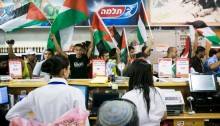 Palestinian, Israeli and international peace protesters break into Rami Levi supermarket in the Sha'ar Binyamin settlement near Jerusalem, to protest against the Israeli occupation and call for a boycott of Israeli settlements, October 2012 (Photo: Activestills)