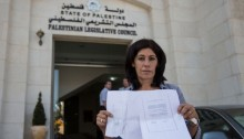 Khalida Jarrar, member of the Palestinian Legislative Council and leader of the Popular Front for the Liberation of Palestine, shows an internal expulsion order by Israeli occupation soldiers who invaded her Ramallah home at on August 20, 2014 ordering her expelled from Ramallah to Jericho within 24 hours, in the city of Ramallah, August 27, 2014 (Photo: Activestills)