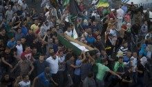 Palestinians carry the body of Mohammed Sinokrot during his funeral in the neighborhood of Wadi Joz in occupied East Jerusalem on September 8, 2014. Mohammed Sinokrot, 16, was wounded by police gunfire in the Wadi Joz on August 31 and died from injuries on September 7 (Photo: Activestills)
