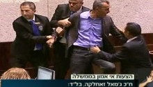MK Jamal Zahalka was forcibly removed from the Knesset podium and dragged out of the plenum on Monday evening after he called Moshe Feiglin, the acting speaker, a fascist. (Photo: Knesset Channel)