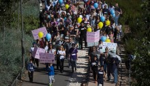 """Thousands of people march through Jerusalem in support of and solidarity with the Max Rayne """"Hand in Hand"""" bilingual school, which was the target of a racist arson attack a week earlier, Jerusalem, December 5, 2014."""