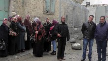 Residents of Bab a-Zawiya neighborhood, Hebron, standing by the closed checkpoint, November 24, 2014.