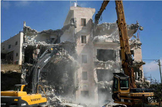 Eight homes in a four-storey block owned by the sons of Mohammed Hammad in Sur Baher, East Jerusalem, in the process of demolition.