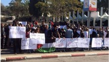 Demonstrators protest against police violence on Tuesday at Tel-Aviv University. Among the protesters were Hadash MKs Muhammad Barakeh and Dov Khenin.