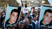 Arab-Bedouin mourners participate in a rally in the southern Israeli city of Rahat to condemn the death of Sami al-Ja'ar, 22, who died of a gunshot wound last week during a police raid in the Negev town, and of Sami al-Ziadna, who was killed during clashes with Israeli police following the funeral of al-Ja'ar. The protesters marched from the house of the al-Ja'ar family to the al-Ziadna family home, January 20, 2015.