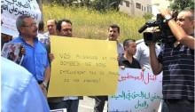 Palestinian journalists demonstrate against last summer's deadly war in Gaza.