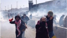 Dozens of Palestinian women suffered from excessive tear gas inhalation and lost consciousness as Israeli forces quelled a peaceful female rally, marking International Women's Day, near the Qalandia checkpoint on Saturday, March 7, 2015.