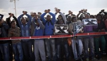 African asylum seekers take part in a protest outside the Holot detention center, in Israel's southern Negev desert, February 17, 2014. The protesters called to close the prison and to recognize the refugee rights of the African asylum seekers living in Israel.