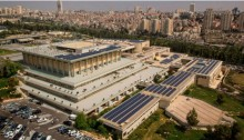 The solar panel array atop the Knesset is part of the Green Knesset Project