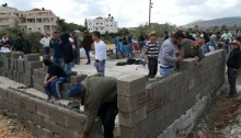 With support from the local Popular Committee, Kafr Kanna residents start rebuilding the demolished home in their town.