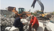 MK Ayman Odeh, left, and the owner of a house demolished in the unrecognized village of Dahamash, near Lod, last week.