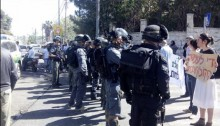 Israeli police forces face demonstrators in at-Tur on Wednesday, April 29.