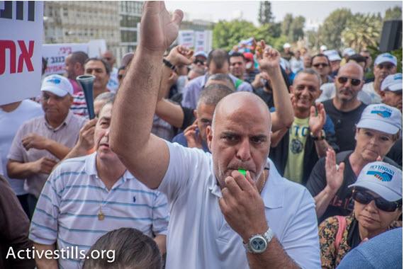 Workers striking ICL demonstrate in Tel-Aviv, last March.