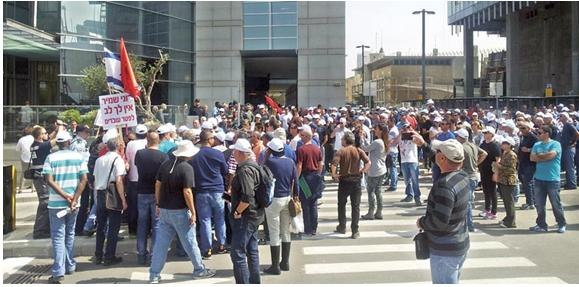 Workers from the Dead Sea Works demonstrate in front of the headquarters of the Israel Chemicals Ltd. in Tel-Aviv, last March.