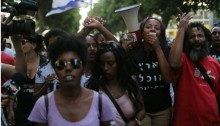 Ethiopian Israelis and their supporters demonstrate on Rothschild Boulevard in Tel Aviv on Monday May 18.
