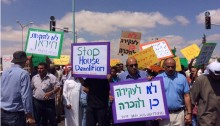 Demonstrators protest the looming demolition of Atir and Umm al-Hiran in Beer-Sheva, June 10.
