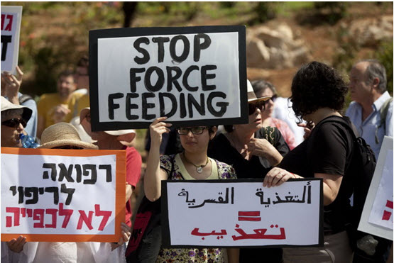 Protest against forced feeding of Palestinian prisoners, Jerusalem, June 16, 2014. Activists and doctors take part in a demonstration in front of the Knesset, organized by Physicians for Human Rights, against the bill to legalize forced feeding of hunger-striking prisoners in Israel.