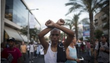Israeli Ethiopians and leftist activists protest against police violence and racism in central Tel Aviv, June 22, 2015. Protesters blocked roads near Rabin square. Police violently arrested at least 15 activists.