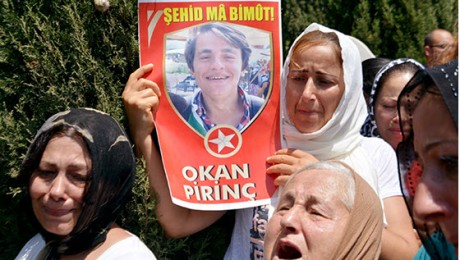 Mourners display photograph of one of the victims in the massacre at Suruç (Pirsûs). (Photo: Al Ittihad)