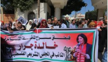 Palestinian demonstrators demand the release of Khalida Jarrar.