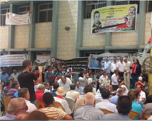 Part of the crowd attending Saturday's solidarity visit at Duma. Addressing the audience, MK Aida Touma-Sliman