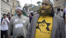 Israeli settlers at the Hebron Jewish settlement's Purim costume parade on the city's segregated Shuhada Street. Honenu attorney Itamar Ben-Gvir (Left), is wearing signs indicating that he is dressed as a hunger-striking Palestinian prisoner. February 24, 2013. A settler on the right is wearing a T-shirt of Kach, which is a designated terrorist group both in Israel and the United States.