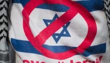 A demonstrator wears a shirt reading 'Boycott Israel'