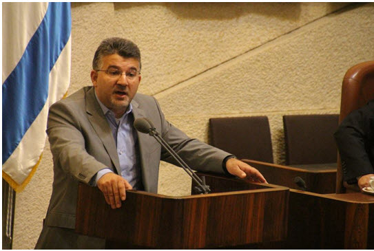 Hadash MK Yousef Jabareen addressing the Knesset during the past summer session.