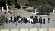 Israeli police escort a group of Jewish visitors to the Al-Aqsa mosque compound in Jerusalem's Old City, on September 28, 2015.