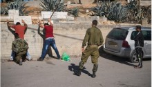 Israeli soldiers search a Palestinian man in Hebron, occupied West Bank, October 21, 2015.
