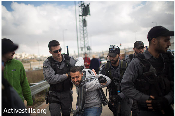 Israeli police arrest a Palestinian organizer of Friday's protest, a member of Combatants for Peace, Beit Jala, West Bank, January 15, 2016.