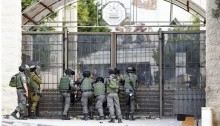 Israeli border guard policemen stand outside Al-Quds University in Abu Dis, a West Bank suburb of Jerusalem, close to Israel's separation wall during clashes with Palestinian demonstrators in October 2015