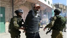 Occupation soldiers arrest peace activist Dr. Kobi Snitz during a protest in Hebron marking 22 years since the Ibrahimi Mosque Massacre, February 20, 2016.