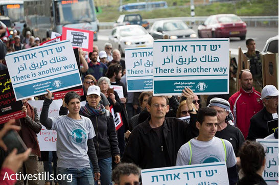 Israeli and Palestinian demonstrators, among them Joint List MK Dov Khenin (Hadash), march against the occupation and to commemorate International Women's Day, Beit Jala, West Bank, March 4, 2016.
