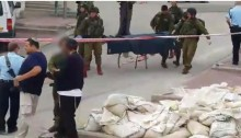 Israeli soldiers carrying the corpse of Abd al-Fatah al-Sharif