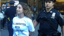 An activist arrested by a police officer during a protest in New York City against occupation of the Palestinian territories