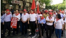 Leaders of Hadash and the Communist Party of Israel (CPI) among the marchers in the May Day parade which was held in Nazareth on April 30. In the first row, from left to right: Issam Makhoul of the Emile Touma Institute; MK Dov Hanin (holding sign); CPI General Secretary Adel Amer; MK Ayman Odeh, head of the Joint List; from the right: MK Aida Touma-Sliman and MK Yousef Jabareen