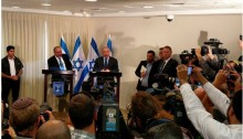 The Prime Minister Benjamin Netanyahu and the racist newcomer to the far-right Israeli government, Defense Minister Avigdor Liberman, address the press following last week's coalition agreement.