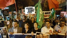 """Among the participants in Saturday night's mass demonstration in Tel-Aviv, from left to right in the front line of march: MK Youssef Jabareen (Joint List-Hadash), MK Michal Rozin (Meretz), Meretz leader MK Zehava Galon, Joint List chairman MK Ayman Odeh (Hadash), and the Secretary General of the Communist Party of Israel, Adel Amer; in the second line, center, MK Dov Khenin (Joint List - Hadash) holds a sign aloft: """"Building an opposition; building hope."""""""