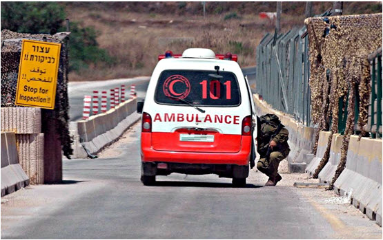 A Palestinian ambulance at an occupation army checkpoint