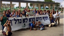 Environmental activist and residents of Nahariya hold a vigil outside the Knesset against the Achziv Beach development project.